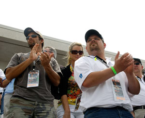 EPIC members applaud at the start of the 92nd Indy 500